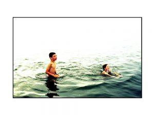Badende im Meer